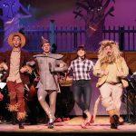 scarecrow, tin man, dorothy, lion on a stage
