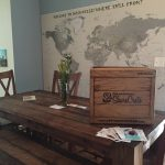 table with crate, map of world on wall