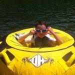 boy wearing goggles swimming in lake