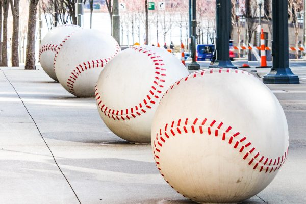 baseball statues on sidewalk