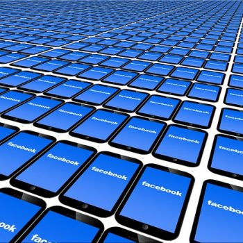 Smart phones with Facebook logo