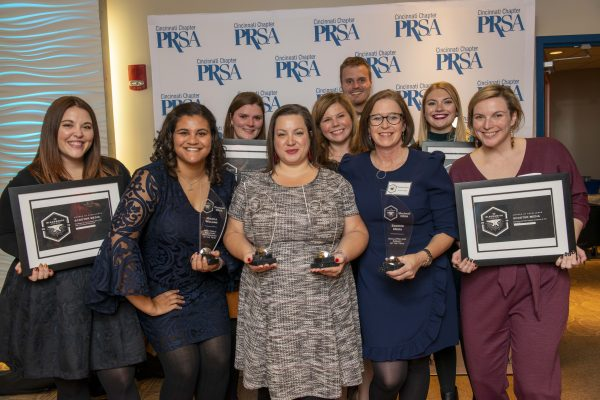 Scooter Media group photo holding awards from Cincinnati PRSA's Annual Blacksmith Awards