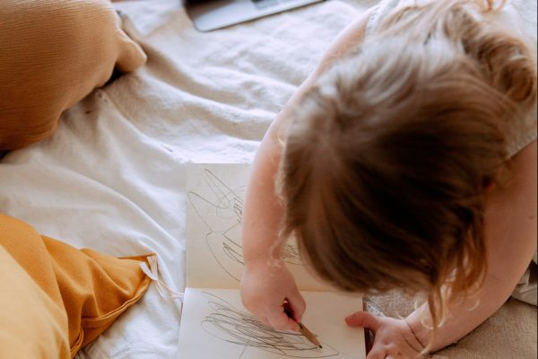 Doodling in a notebook is often a child's first artistic expression