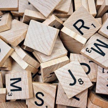 Pile of messy Scrabble letter tiles