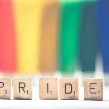 Pride Scrabble Tiles in front of rainbow