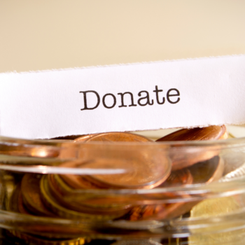 Donate on a piece of paper placed on top of a jar of pennies
