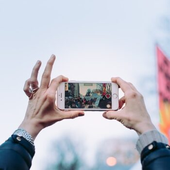 Person taking video footage in a crowd