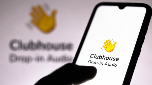 Phone tapping the Clubhouse app on a phone