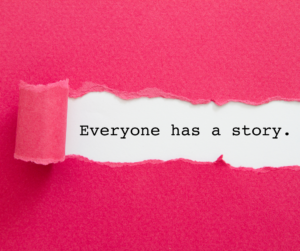 """Bright pink paper with a rolling tear revealing the text, """"Everyone has a story."""" against a white background"""