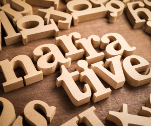 A jumble of wooden letters spelling the word narrative at the center