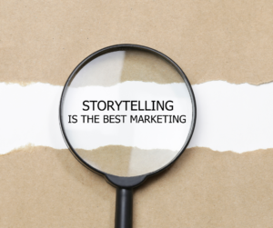"""A magnifying glass centered on """"storytelling is the best marketing"""" text"""