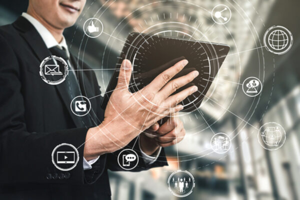 Businessman holding template surrounded by social media icons