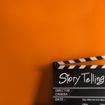 """Clapboard with the word """"storytelling"""" displayed"""