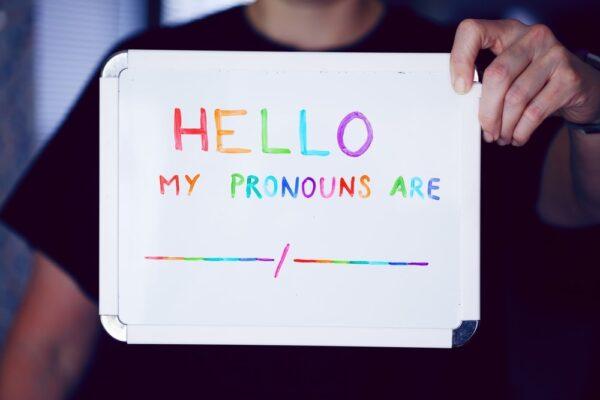 "Dry-erase board with the phrase ""Hello! My pronouns are:"""